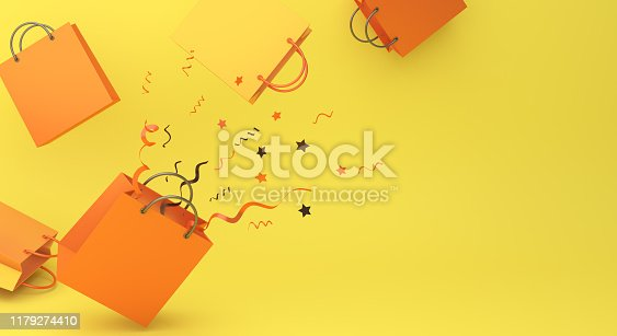 istock Orange color shopping bag and confetti on yellow background, copy space text, Design creative concept for halloween day or autumn sale event. 1179274410
