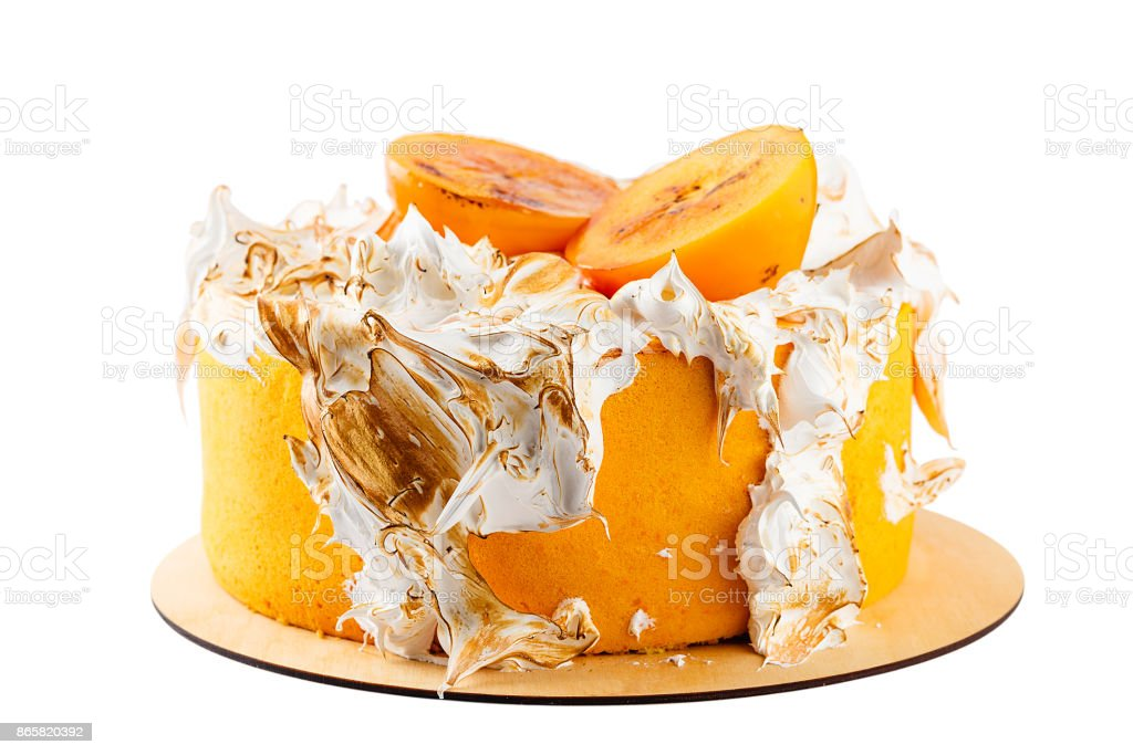 Orange colored cake with persimmon and Italian burned meringue isolated on white stock photo