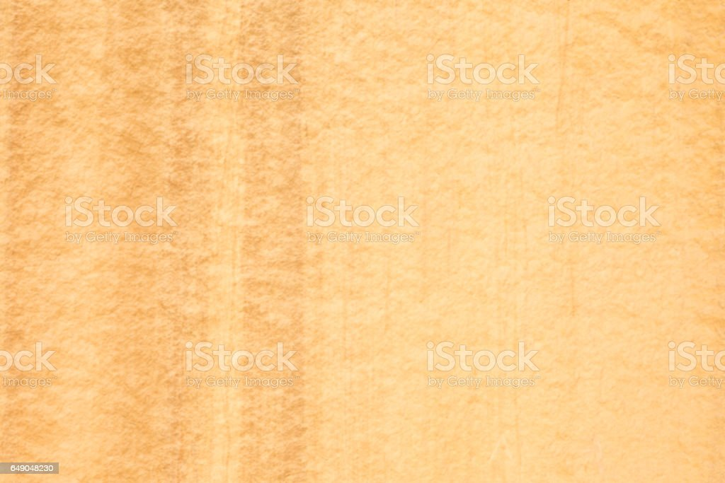 Orange colored desert varnish on sandstone cliff wall stock photo