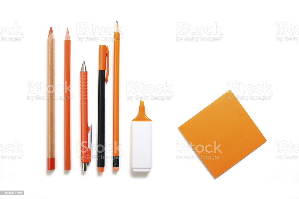 orange colored pen, pencil, highlighter and post it royalty-free stock photo