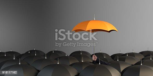 istock Orange Colored Umbrella Between The Black Umbrellas 918117162
