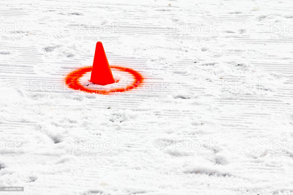 Orange cone as slalom marking for a skijoring competition stock photo