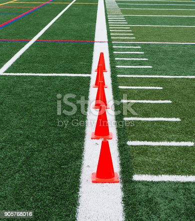 986840244istockphoto Orange cones lined up on a white line 905768016