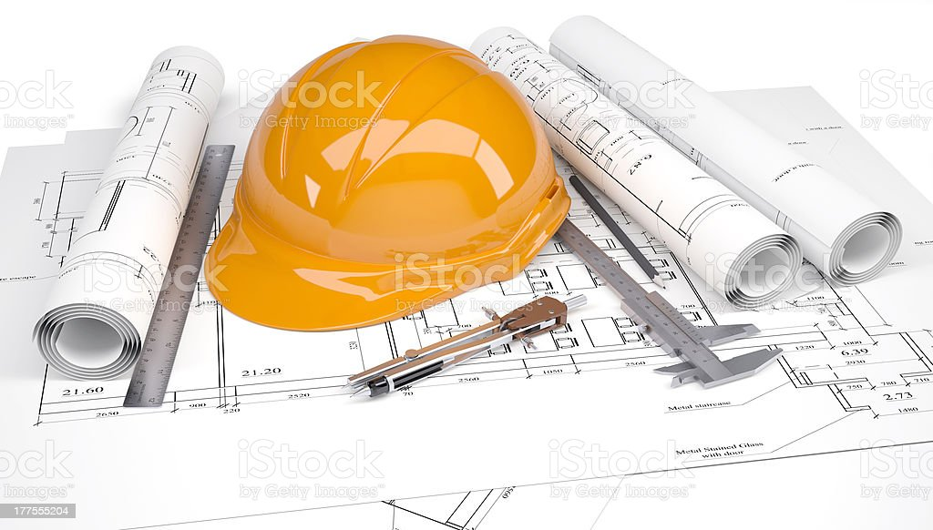 Orange construction helmet on the architectural drawings with engineering tools royalty-free stock photo
