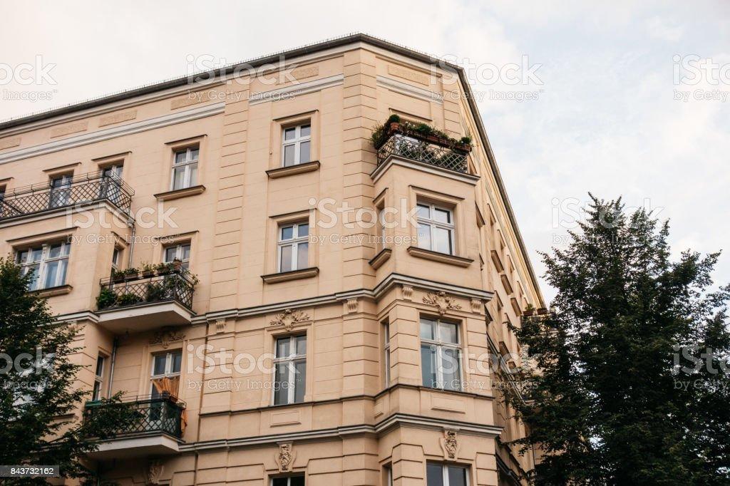 orange corner house in prenzlauer berg stock photo