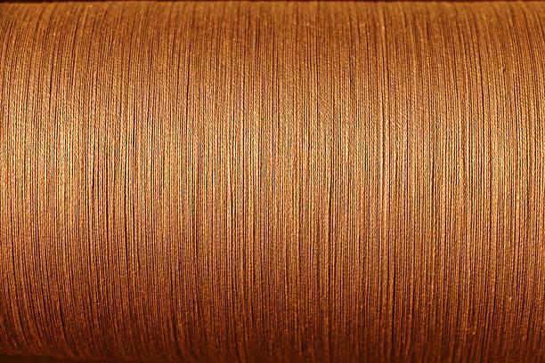 orange cotton thread from weaving machine, Abstract background - foto de stock