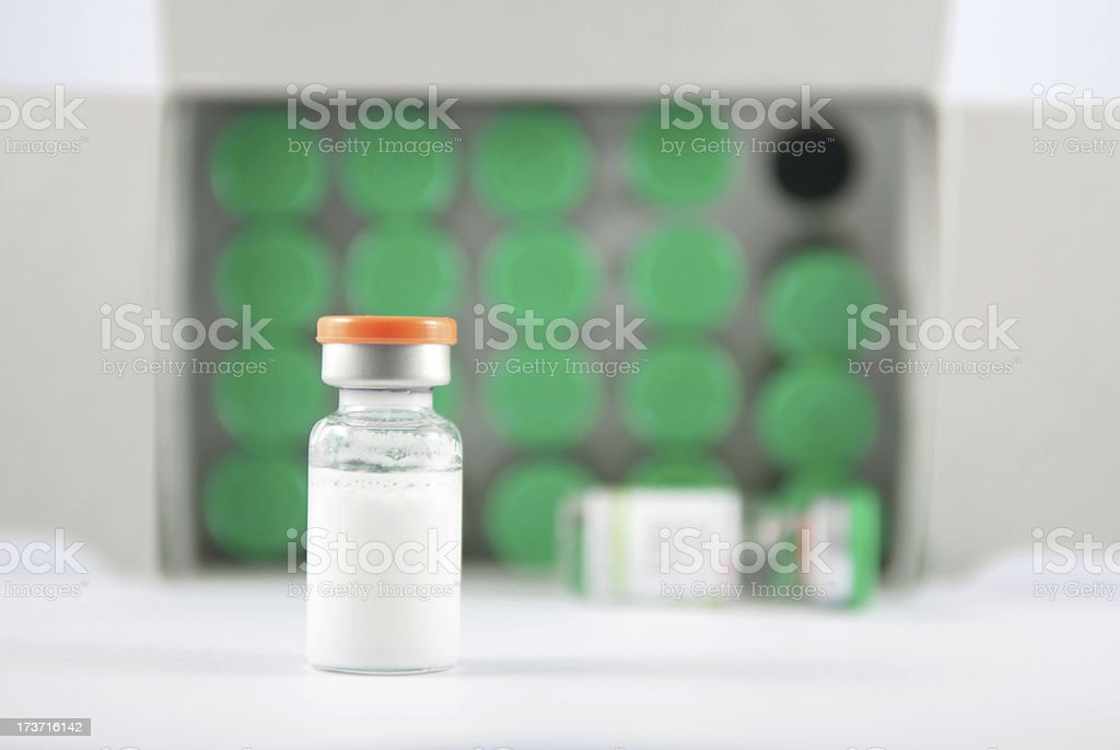 Orange cover injection vial on green vials background stock photo