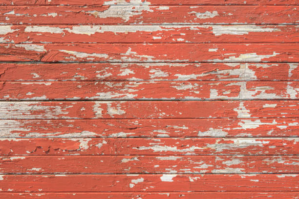 Orange cracked paint wood stock photo