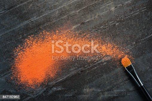 847152928 istock photo orange crushed powder and makeup cosmetic brush 847152952