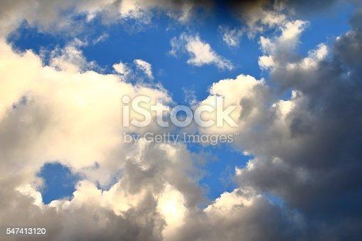istock Orange dark clouds on blue sky textured background with wind 547413120