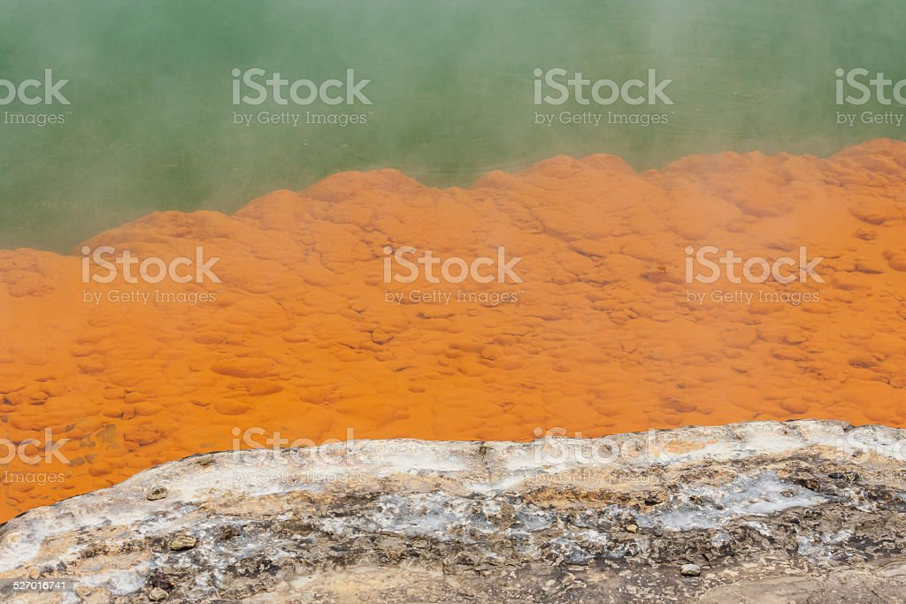 orange deposits on ledges of Champagne pool stock photo