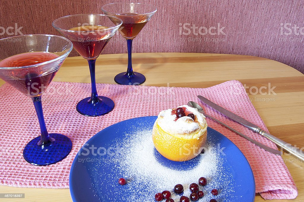 Orange dessert with barry and three glasses of wine royalty-free stock photo