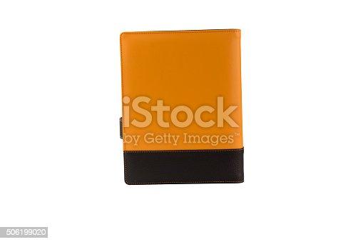 istock Orange diary book isolated on white 506199020