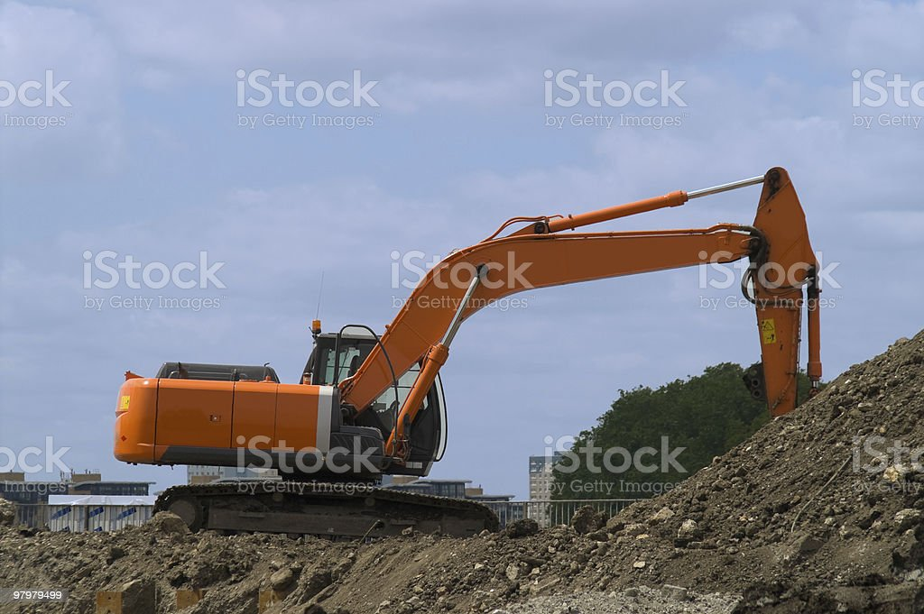 Orange digger royalty-free stock photo