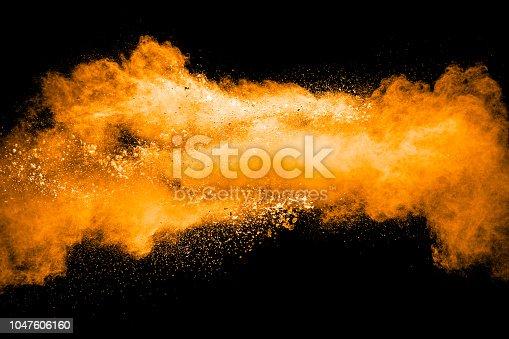 1040055260istockphoto orange dust particles explosion on black background. Color powder dust splash. 1047606160
