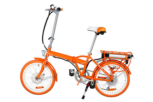 Orange electric bike Orange folding electric bike isolated on a white background with a full clipping path foldable stock pictures, royalty-free photos & images