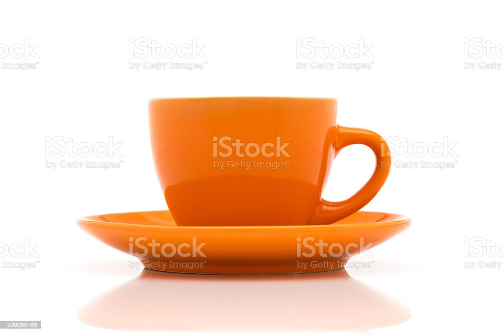 Orange espresso cup and saucer stock photo