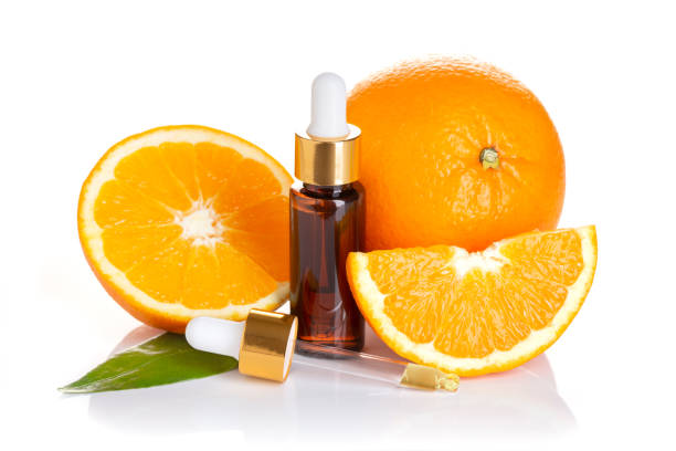 Orange essential oil isolated on white background stock photo