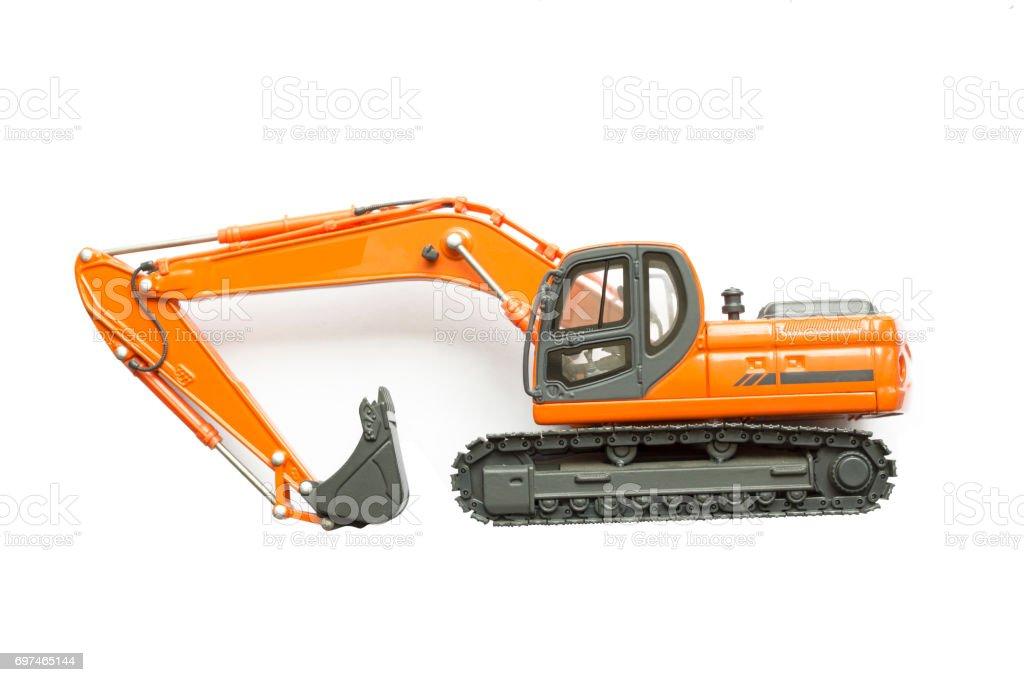 Orange Excavator toy Isolated on white background. stock photo