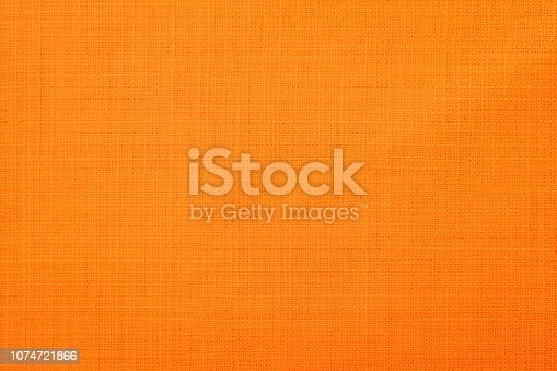 istock Orange fabric background 1074721866