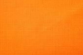 オレンジのファブリックの背景