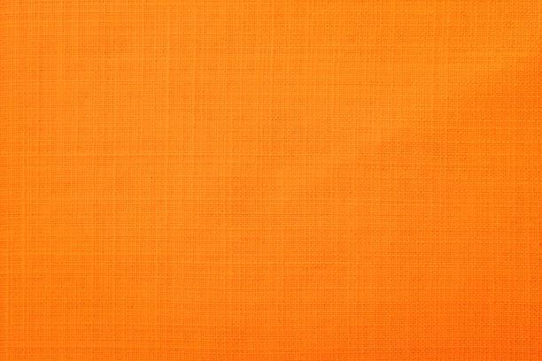 orange fabric background - tovaglia foto e immagini stock