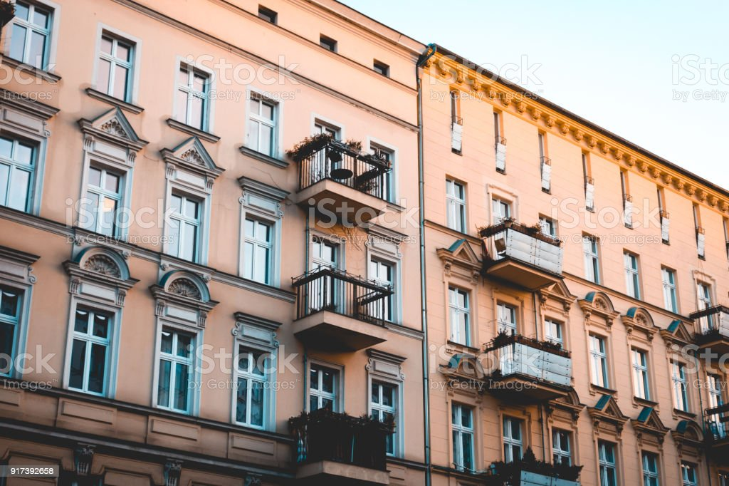 orange facaded buildings with warm colors stock photo
