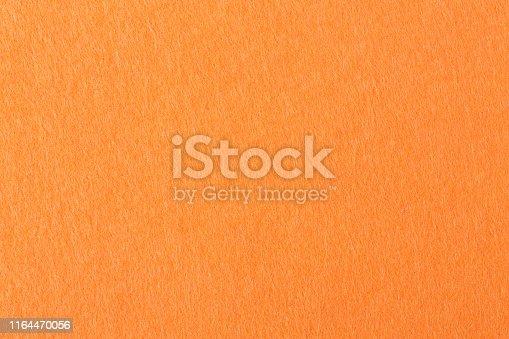 Orange felt background on macro. High resolution photo.