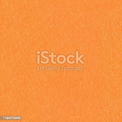 Orange felt background on macro. Seamless square texture, tile ready. High resolution photo.