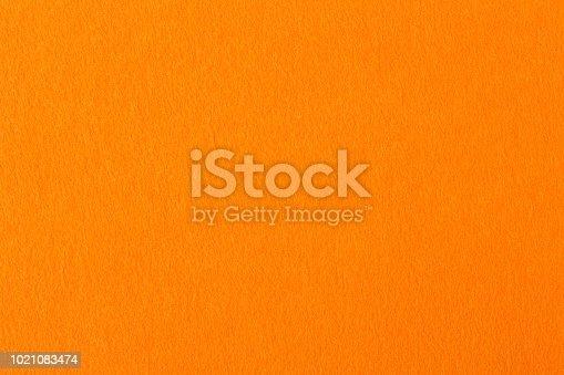 Orange felt texture for design. High resolution photo.