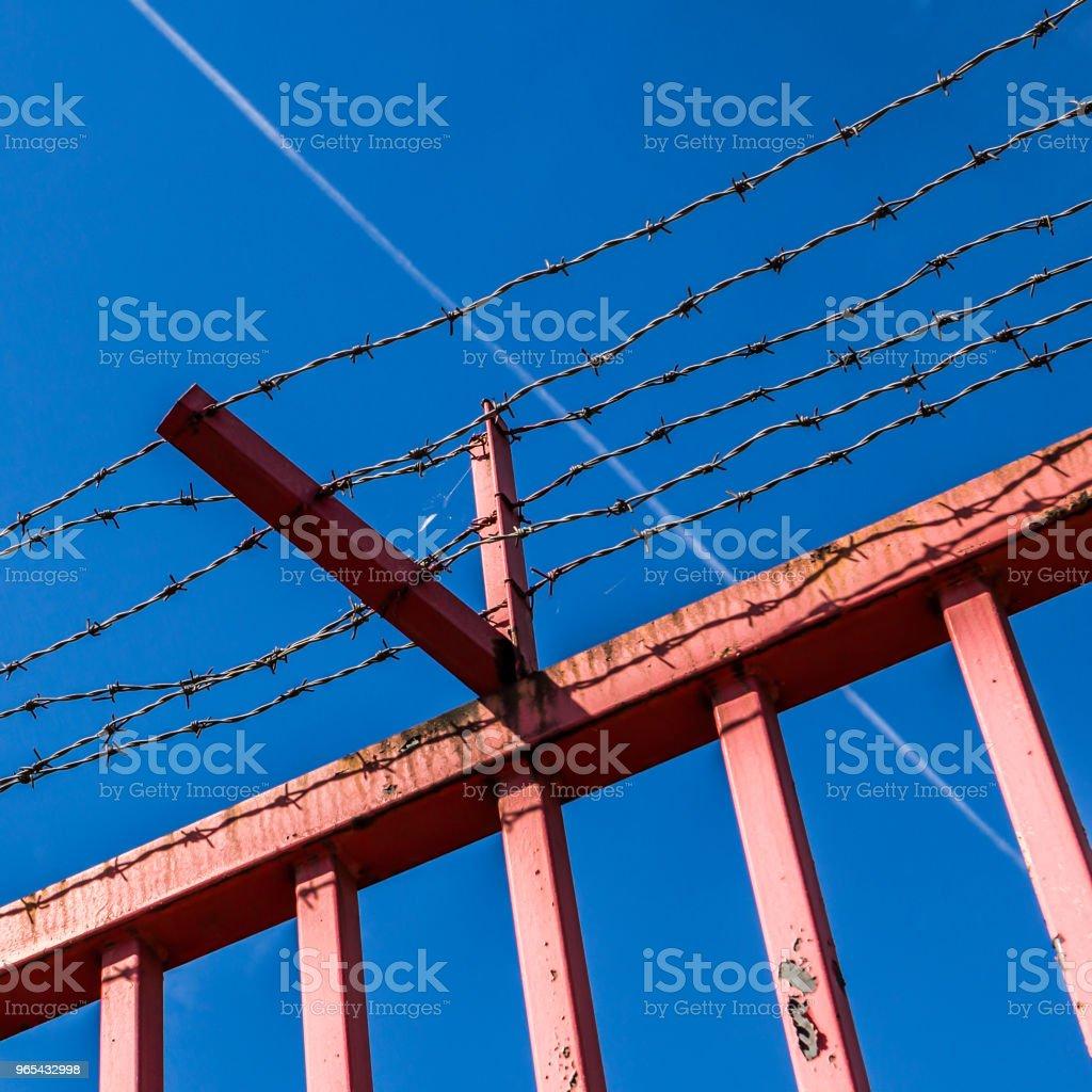 Orange fence and blue sky zbiór zdjęć royalty-free
