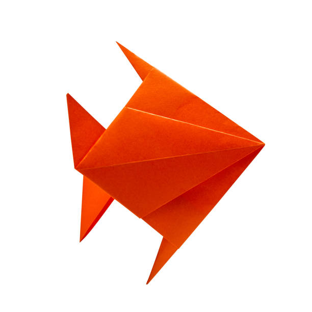 Orange fish in Origami isolated on white stock photo