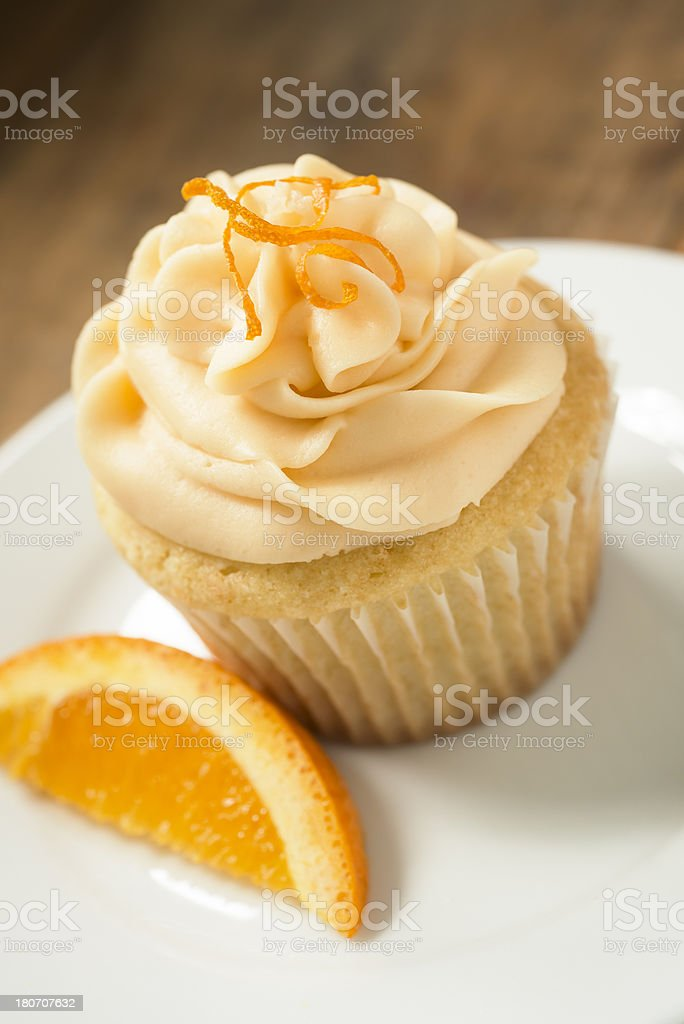 Orange Flavored Cupcake on a White Plate with Copy Space royalty-free stock photo