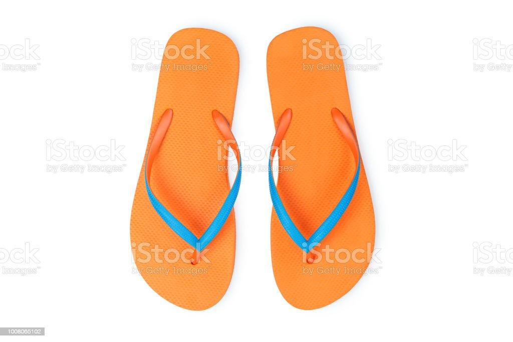 97f2f841e5e3 Orange Flip Flops Isolated On White Background. Top View - Stock image .