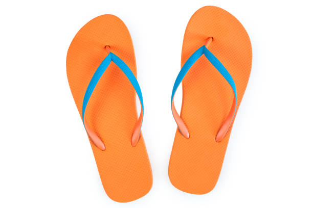 1a930785f Orange Flip Flops Isolated On White Background. Top View stock photo