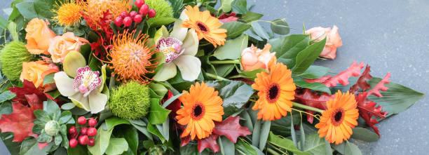 Orange flower arrangement floral banner picture id1156394371?b=1&k=6&m=1156394371&s=612x612&w=0&h=lk1y5czfxph6vzv1hwffn4z ogzjo8tvny3mqes9y c=