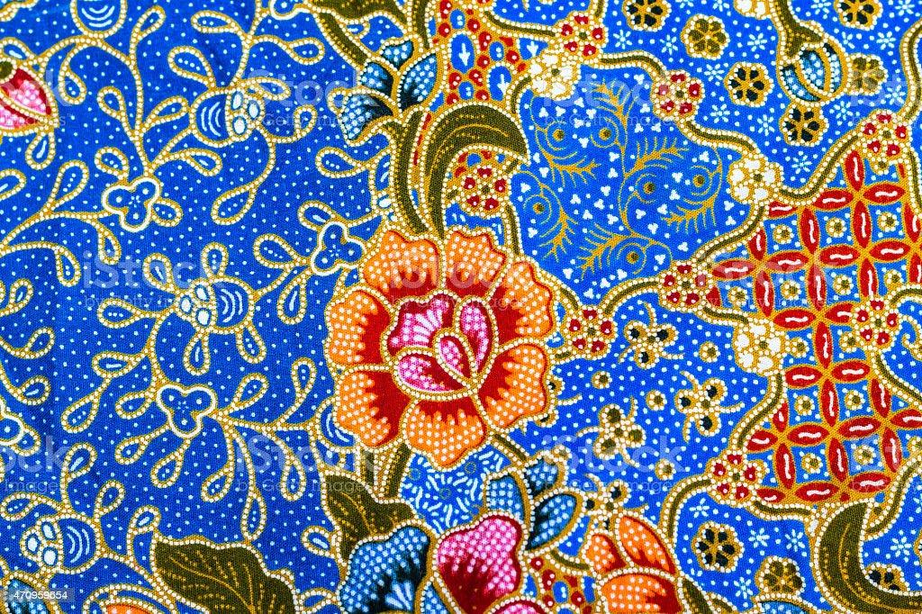 Orange flower pattern on batik stock photo