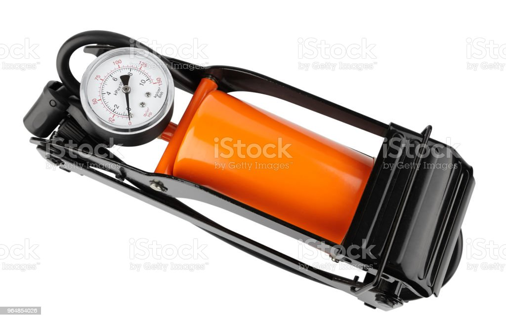 orange foot pump for a car with a manometer, top view isolated on white royalty-free stock photo