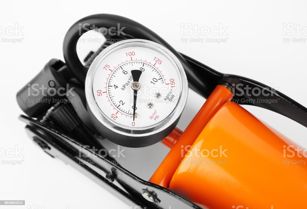 orange foot pump for a car with a manometer, top view royalty-free stock photo