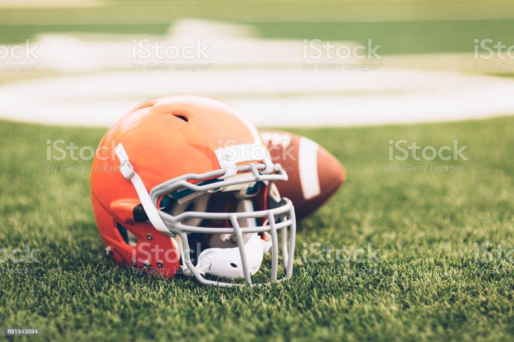 Orange Football Helmet on Field stock photo
