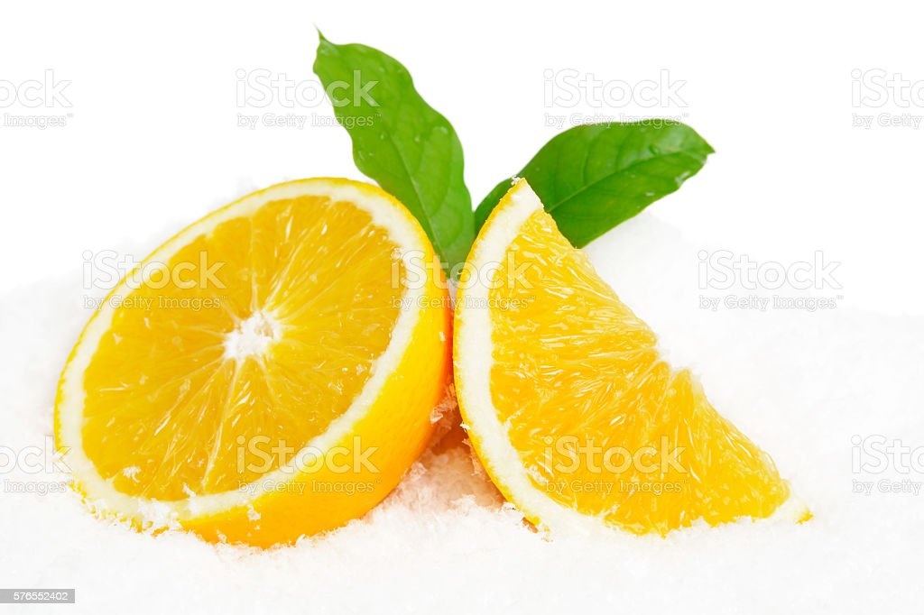 Orange fruit and leaves on ice on white stock photo