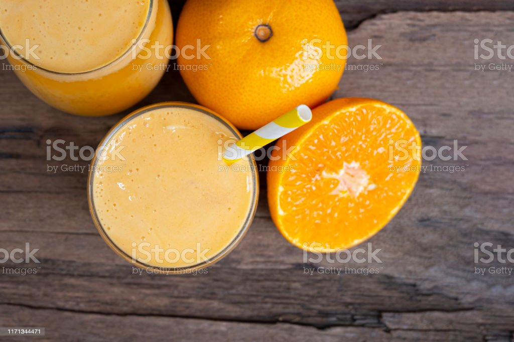 Orange Fruit Juice Smoothie Yellow Juice Drink Healthy Delicious Taste In A Glass For Weight Loss On Wooden Background From Top View Stock Photo Download Image Now Istock