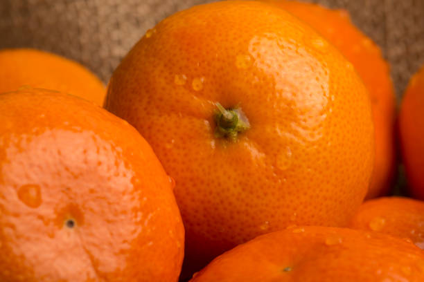 Orange fruit Macro photography Weight loss solution concept. Good source of Vitamin C stock photo
