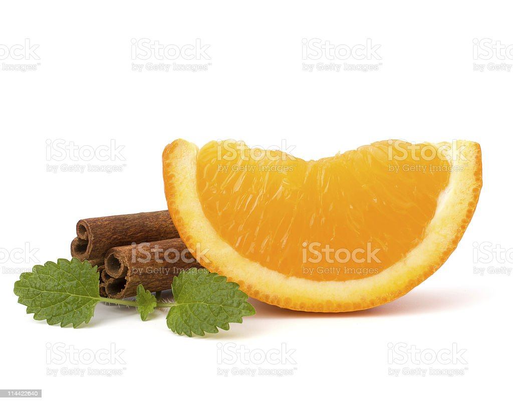 Orange fruit part, cinnamon stick and green mint royalty-free stock photo