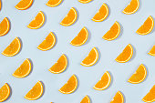 Orange slices seamless background on blue background