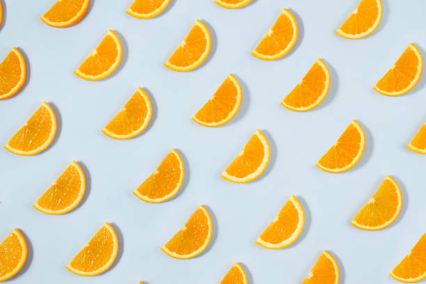 Orange Fruit Pattern on Blue Background stock photo
