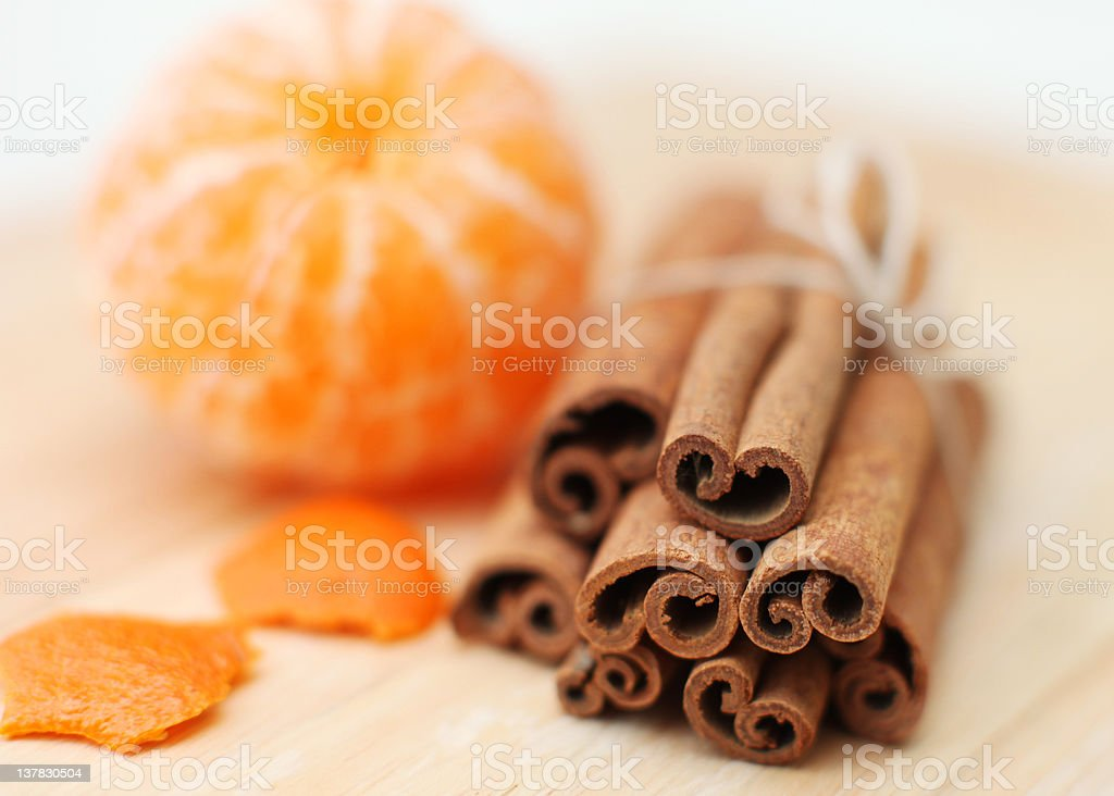 Orange fruit segment and cinnamon sticks royalty-free stock photo
