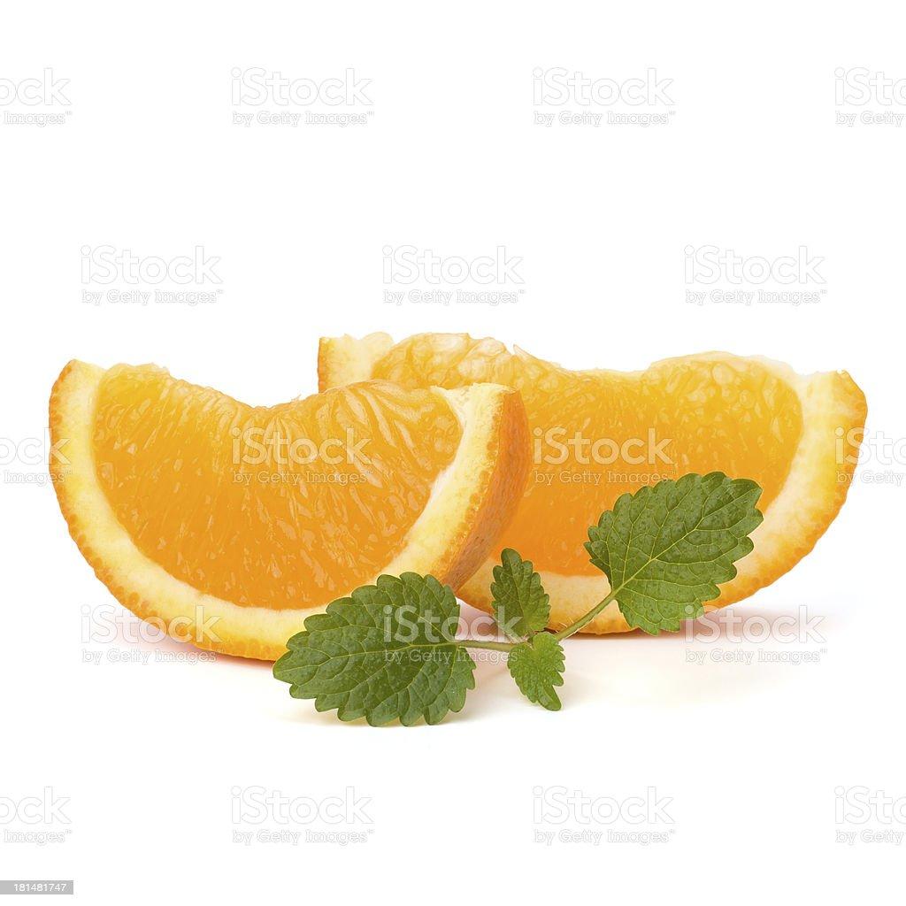 Orange fruit segment and citron mint leaf royalty-free stock photo