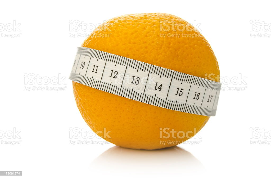 Orange fruit wrapped with measuring tape stock photo