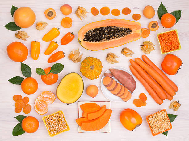 Orange fruits and vegetables containing beta carotene stock photo
